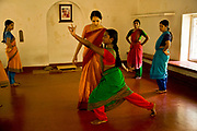 "Ganga Thampi, teaches young  trainee dancers  movement, rhythm and expression, known as nritya at the traditional and highly prestigious Kalakshetra school for the arts, Chennai. The school was founded in 1936 and due to its exacting and demanding schedule is considered India's formost classical dance academy of this ancient cultural art heritage that is informally known as ""temple dancing"" and that dates back to the Natya Shastra, the 2000 year old text that lays down the principles of Indian dramatic theory and performance. Tamil Nadu, India."