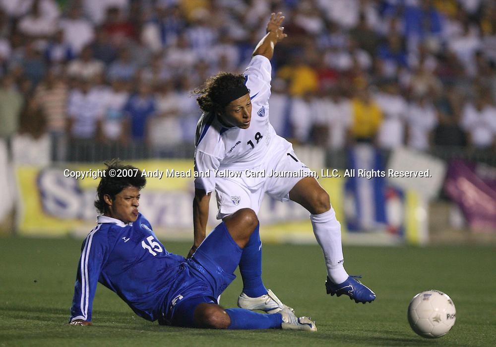 El Salvador's Manuel Salazar (15) tackles the ball away from Honduras's Jairo Martinez (18) on Tuesday, March 27th, 2007 at SAS Stadium in Cary, North Carolina. The Honduras Men's National Team defeated El Salvador 2-0 in a men's international friendly.