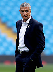 Brighton & Hove Albion manager Chris Hughton inspects the pitch before the Premier League match at the Etihad Stadium, Manchester.