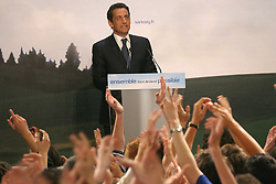UMP candidate Nicolas Sarkozy delivers his speech at Salle Gaveau in Paris, France, April 22, 2007, after the broadcast of the results on tv. Sarkozy finished first in the opening round of France's presidential election on Sunday and will meet Socialist rival Segolene Royal in a run-off vote, initial returns showed. With 40 percent of the vote counted, Sarkozy had 30.5 percent of the vote, Royal was in second place on 24.3 percent and centrist Francois Bayrou in third place on 18.2 percent. Far-right leader Jean-Marie Le Pen, who stunned France by coming second in the 2002 election, looked set to finish a distant fourth with around 11.5 percent. Photo by Nebinger-Taamallah/ABACAPRESS.COM