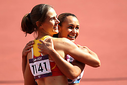 Jessica Innes of Great Britain celebrates with Sara Aerts of Belgium after the 100m Hurdles as part of the Women's Heptathlon during day 1 of athletics held at the Olympic Stadium in Olympic Park in London as part of the London 2012 Olympics on the 3rd August 2012..Photo by Ron Gaunt/SPORTZPICS