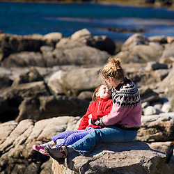 A mom and her daughter (age 6) enjoy a Maine Coast view in Biddeford, Maine.  Timber Point.