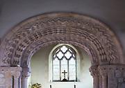 Elaborately decorated stone 12th century Norman chancel arch inside the historic village parish church  Marden, Wiltshire, England, UK