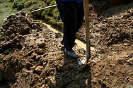 Yilmaz Civelek, 47, at home in Alaca Yaylası, helping to dig a well in his home village up in the Pontic mountains, where communicating via whistling is common, due to the large distances between homes, and the mountainous landscape.