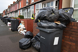 © Licensed to London News Pictures. 15/01/2019. Birmingham, West Midlands UK. Pictured, piles of rubbish in Kenelm Road, Small Heath. The Birmingham Bin Strike enters a third week and large piles of uncollected rubbish are starting to appear on the streets of inner City Birmingham. The Refuse collectors took strike action in 2018 and forced a change of Council Leadership. Residents have complained of seeing rats and white worms outside their houses. Photo credit: Dave Warren/LNP