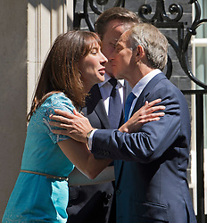 © London News Pictures. 24/07/2012. London, UK. Former British Prime Minister TONY BLAIR being greeted by British Prime Minister DAVID CAMERON and SAMANTHA CAMERON on the steps of 10 Downing street before a lunch with Prime Minister David Cameron on July 24, 2012. Photo credit: Ben Cawthra/LNP.