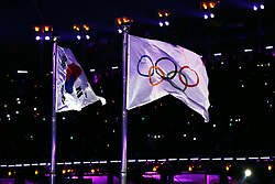 The South Korean and Olympic Flag during the Opening Ceremony of the PyeongChang 2018 Winter Olympic Games at the PyeongChang Olympic Stadium in South Korea. PRESS ASSOCIATION Photo. Picture date: Friday February 9, 2018. See PA story OLYMPICS Ceremony. Photo credit should read: Mike Egerton/PA Wire. RESTRICTIONS: Editorial use only. No commercial use.