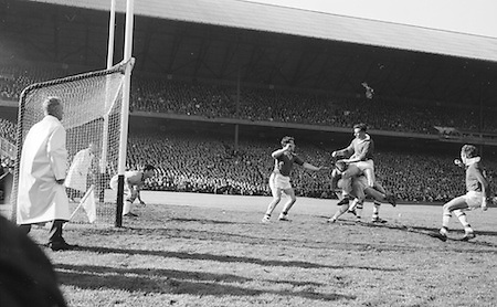 Meath full back J. Quinn lands on top of player in possession of ball during the All Ireland Senior Gaelic Football Final Cork v. Meath in Croke Park on the 24th September 1967. Meath 1-9 Cork 0-9.