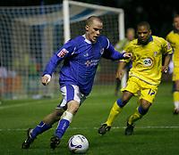 Photo: Steve Bond.<br />Leicester City v Leeds United. Coca Cola Championship. 13/03/2007. Iain Hume (left) attacks  Sebastien Carole (right)