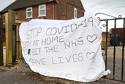 A gated house with a hand drawn sign warning people to stay at home, stop the spread of COVID-19, protect the NHS, and save lives is displayed as the UK continues in lockdown to help curb the spread of the coronavirus.