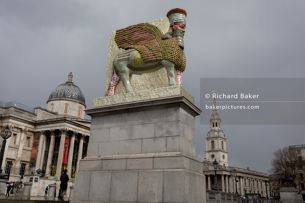 The 12th Fourth Plinth commission by the Mayor of London  artwork entitled 'The Invisible Enemy Should Not Exist' by the artist Michael Rakowitz, in Trafalgar Square, on 29th March, 2018 in London, England. Started in 2006, the sculpture recreates over 7,000 archaeological artefacts looted from the Iraq Museum during the war there or destroyed elsewhere. Oneof these was Lamassu, a winged deity which guarded Nergal Gate at the entrance to the ancient city Assyrian city of Nineveh (modern-day Mosul, Iraq) which was destroyed by ISIS in 2015. The Lamassu, which had the same footprint as the Fourth Plinth is made of empty Iraqi date syrup cans, representative of a once-renowned industry.