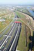 Nederland, Utrecht, Utrecht, 24-10-2013;<br /> Rijksweg A2 en de zuidelijke ingang van de  Leidsche Rijntunnel, een landtunnel die de verkeersoverlast, luchtvervuiling en geluidsoverlast voor Utrecht en de Vinexwijk Leidsche Rijn moet verminderen. Rechts het Amsterdam-Rijnkanaal  met de stad Utrecht. Stadsbaan links van de tunnel.<br /> Roadway A2 and the southern entrance to the tunnel Leidsche Rijn, a landtunnel built to decrease the nuisance of traffic noise and air pollution for the city of Utrecht and the suburb Leidsche Rijn (l) . Right the Amsterdam-Rhine Canal and the city of Utrecht.<br /> luchtfoto (toeslag op standaard tarieven);<br /> aerial photo (additional fee required);<br /> copyright foto/photo Siebe Swart.