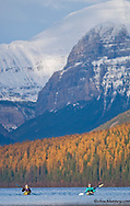 Sea kayakers on Bowman Lake in autumn in Glacier National Park in Montana model released