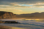 Coastal cliffs above Drakes Beach at sunrise, Point Reyes National Seashore, Marin County, California