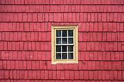 Colorful shingle facade and window.