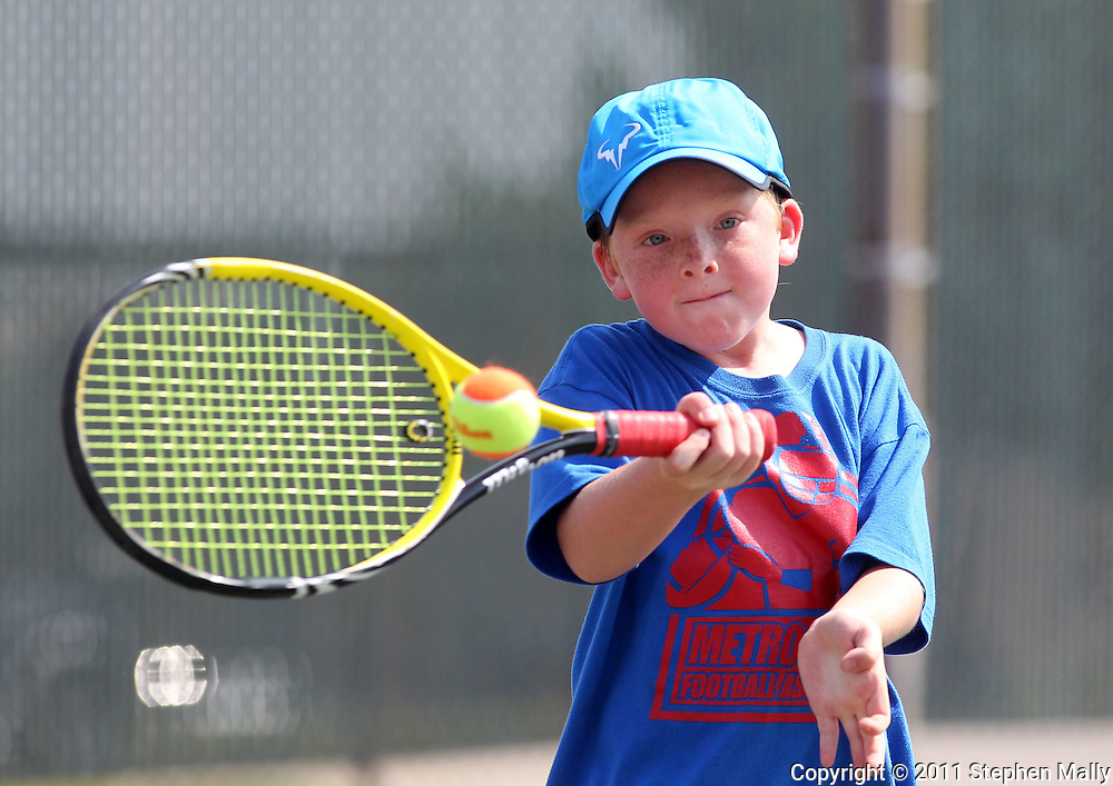 Grayson Zylstra, 9, of Cedar Rapids returns the ball during a Boys' 10 Singles match at the 2011 Baird Iowa Open tennis tournament at Westfield Tennis Club in Cedar Rapids on Wednesday, July 27, 2011. Over 200 players from Colorado, Illinois, Iowa, and South Dakota, participated in the event.