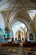 Interior of the medieval fortified church of Harman. A Romaneque church started in 1240 by the Cistercian monks with elements of Gothic  architecture .Harman, Braşov, Transylvania. UNESCO World Heritage Site. .<br /> <br /> Visit our ROMANIA HISTORIC PLACXES PHOTO COLLECTIONS for more photos to download or buy as wall art prints https://funkystock.photoshelter.com/gallery-collection/Pictures-Images-of-Romania-Photos-of-Romanian-Historic-Landmark-Sites/C00001TITiQwAdS8<br /> .<br /> Visit our MEDIEVAL PHOTO COLLECTIONS for more   photos  to download or buy as prints https://funkystock.photoshelter.com/gallery-collection/Medieval-Middle-Ages-Historic-Places-Arcaeological-Sites-Pictures-Images-of/C0000B5ZA54_WD0s