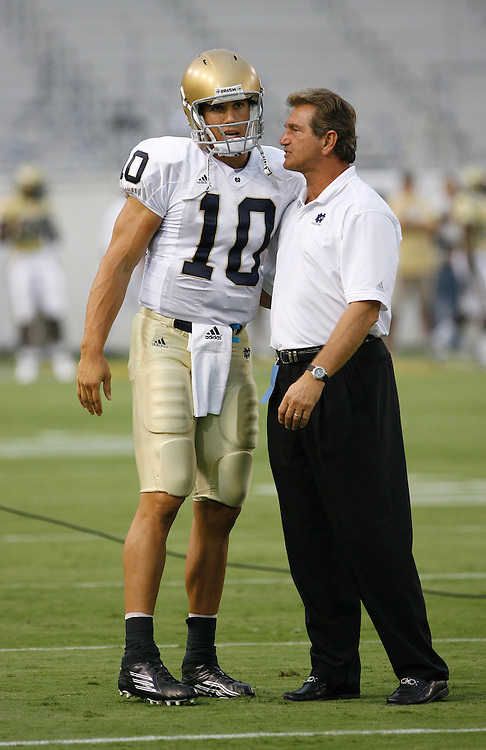 Notre Dame QB Brady Quinn talks with Joe Theismann before the game against Georgia Tech at Grant Field in Bobby Dodd Stadium in Atlanta, GA on September 2, 2006.  The Fighting Irish beat the Yellow Jackets 14-10.