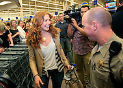 Twilight star Rachelle Lefevre, who plays character Victoria, greets excited Twilight fans at the Walmart store in Riverton, Utah during the midnight DVD movie release event March 21, 2009. (AP Photo/Colin Braley)