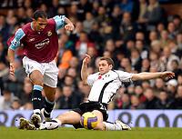 Photo: Alan Crowhurst.<br />Fulham v West Ham United. The Barclays Premiership. 23/12/2006. Moritz Volz of Fulham (R) challenges Anton Ferdinand.