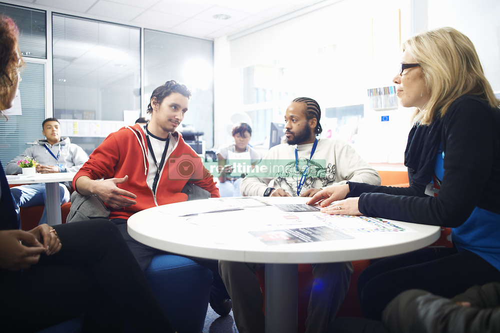May 14, 2014 - Female lecturer and a group of college students having informal discussion in classroom (Credit Image: © Image Source/Image Source/ZUMAPRESS.com)