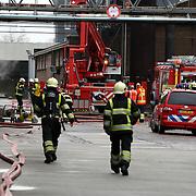NLD/Huizen/20080205 - Brand op dak in ventilatiekanaal bij BNI Huizen