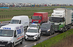 © Licensed to London News Pictures 23/12/2020.        Manston, UK. Local traffic queuing on roads around the airport after the blockade. The Army and NHS staff have arrived at Manston Airport to administer Covid-19 lateral flow tests to truckers who are stranded in Kent. Angry lorry drivers blockading local roads and clashed with police in Kent this morning. France have closed its borders to all freight traffic because of the new Coronavirus strain. Photo credit:Grant Falvey/LNP