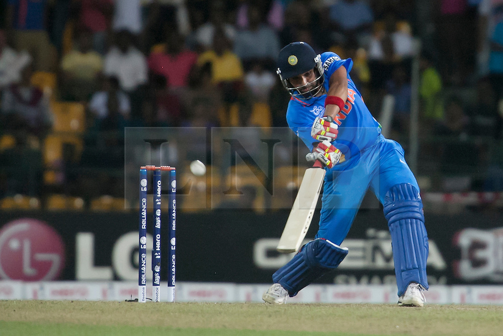 © Licensed to London News Pictures. 23/09/2012. Indian batsman Rohit Sharma batting during the T20 Cricket World T20 match between England Vs India at the R.Premadasa Cricket Stadium,Colombo. Photo credit : Asanka Brendon Ratnayake/LNP