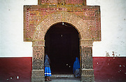 Purepecha Indian women stand in the doorway of the church in Angahuan, Michoacan, Mexico, the jumping-off point to the Paricutin volcano.