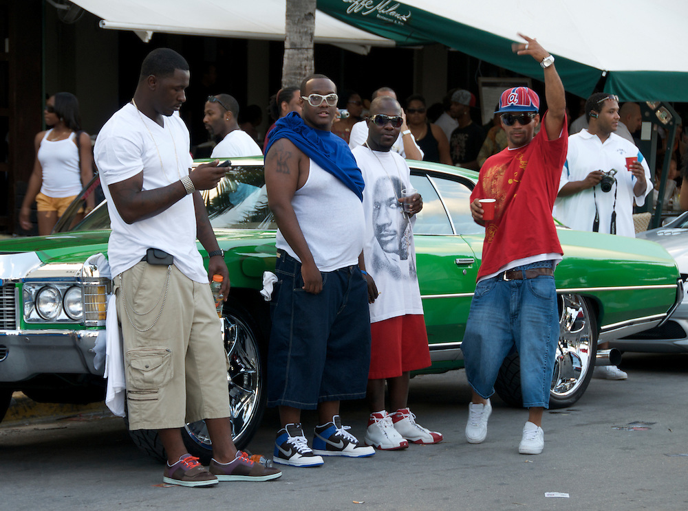 Group of boys shows with pride their tuned car in the 2008 Miami Beach Urban Weekend. The Miami Beach Urban weekend in the largest Urban Festival in the World, that caters toward the Hip Hop Generation. Over 300.000 participants make the annual trek to South Beach for 4 days full of fun, food, festivities, entertainment, music, and more.