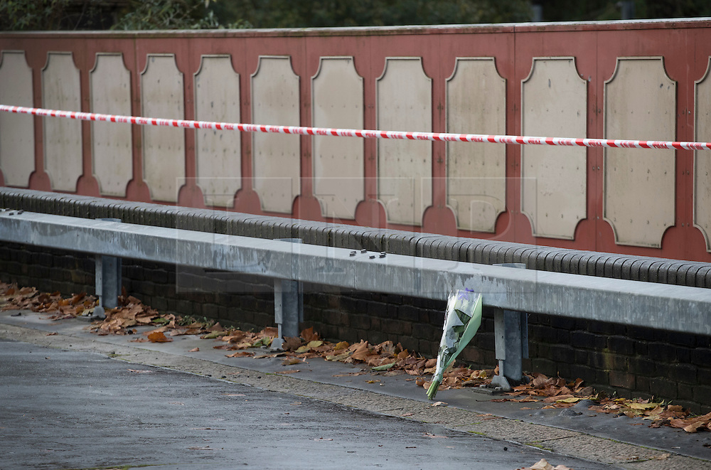 © Licensed to London News Pictures. 10/11/2016. Croydon, UK. A lone bouquet of of flowers is placed in tribute to the victims of the Croydon tram crash at the nearest bridge. Investigations are continuing into a tram crash that police say claimed seven lives and injured 50. The driver has been arrested and is being questioned by police. Photo credit: Peter Macdiarmid/LNP