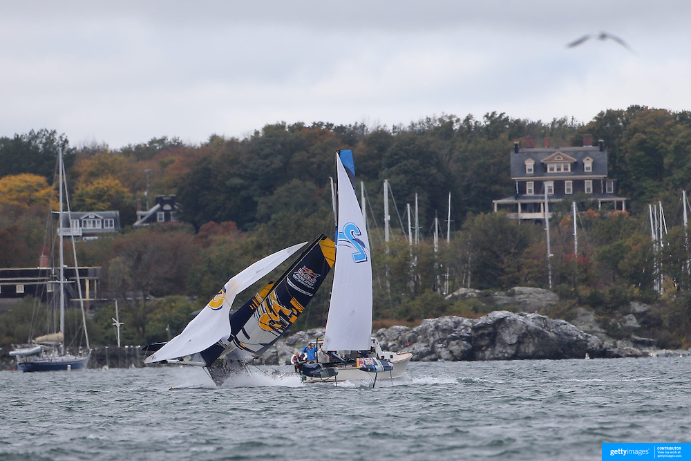 NEWPORT, RHODE ISLAND- OCTOBER 22:  The German team, (left), of Jasper Steffens and Tom Lennart Brauckmmann capsize as the Belgium team of Alec Bague and Wirtz Morgan take evasive action during the Red Bull Foiling Generation World Final 2016 on October 22, 2016 in Narragansett Bay, Newport, Rhode Island. (Photo by Tim Clayton/Corbis via Getty Images)