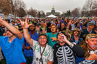 Crowd smoking pot at 4:20 PM, 420 Cannabis Culture Music Festival, Civic Center Park, Downtown Denver, Colorado USA. This was the first 4/20 celebration since recreational pot became legal in Colorado January 1, 2014. A crowd of up to 80,000 people attended the event.