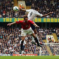 Photo. Daniel Hambury.<br />The Barclays Premiership.<br />Tottenham Hotspur V Manchester United. 25/09/2004.<br />Spurs' and Manchester United's Gabriel Heinze