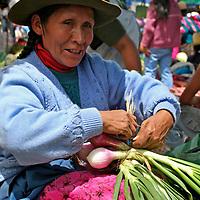 Americas, South America, Peru, Pisac. Onions for sale at Pisac Market.