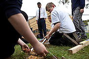 Keith Webber supervises students clearing an area made available for more food production on the College site working with the Growing the Futures project. Okenhampton College, Devon.