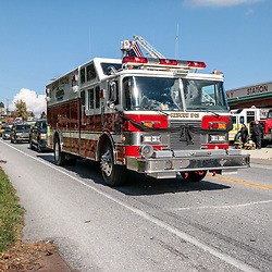 Peach Bottom, PA, USA - October 30, 2014: A fire truck adorned with black bunting in the funeral procession of fallen volunteer firefighter Christi Marie Rodgers.