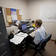 Dr. Steve Amstrup, USGS bioogist, analyzing data from recent polar bear captures at the U.S. Fish and Wildlife house in Kaktovik, Alaska.