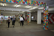 Colourful temporary subterranean walkway under a road in Birmingham, United Kingdom. This is an area under redevelopment in the city centre.