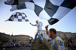 St Mirren fans cheer the bus as it passes by during the winner's parade through Paisley.