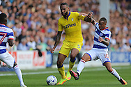 Tjarron Chery of QPR intercepts Kyle Bartley of Leeds United. Skybet EFL championship match, Queens Park Rangers v Leeds United at Loftus Road Stadium in London on Sunday 7th August 2016.<br /> pic by John Patrick Fletcher, Andrew Orchard sports photography.