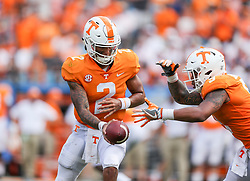 Sep 1, 2018; Charlotte, NC, USA; Tennessee Volunteers quarterback Jarrett Guarantano (2) hands the ball off to Tennessee Volunteers running back Tim Jordan (9) during the second quarter against the West Virginia Mountaineers at Bank of America Stadium. Mandatory Credit: Ben Queen-USA TODAY Sports
