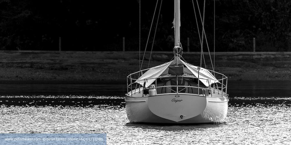 Caper at anchor in Bon Accord Harbour, Hauraki Gulf, Auckland.