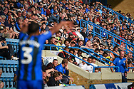The fans watch a throw-in during the EFL Sky Bet League 1 match between Gillingham and Coventry City at the MEMS Priestfield Stadium, Gillingham, England on 25 August 2018.