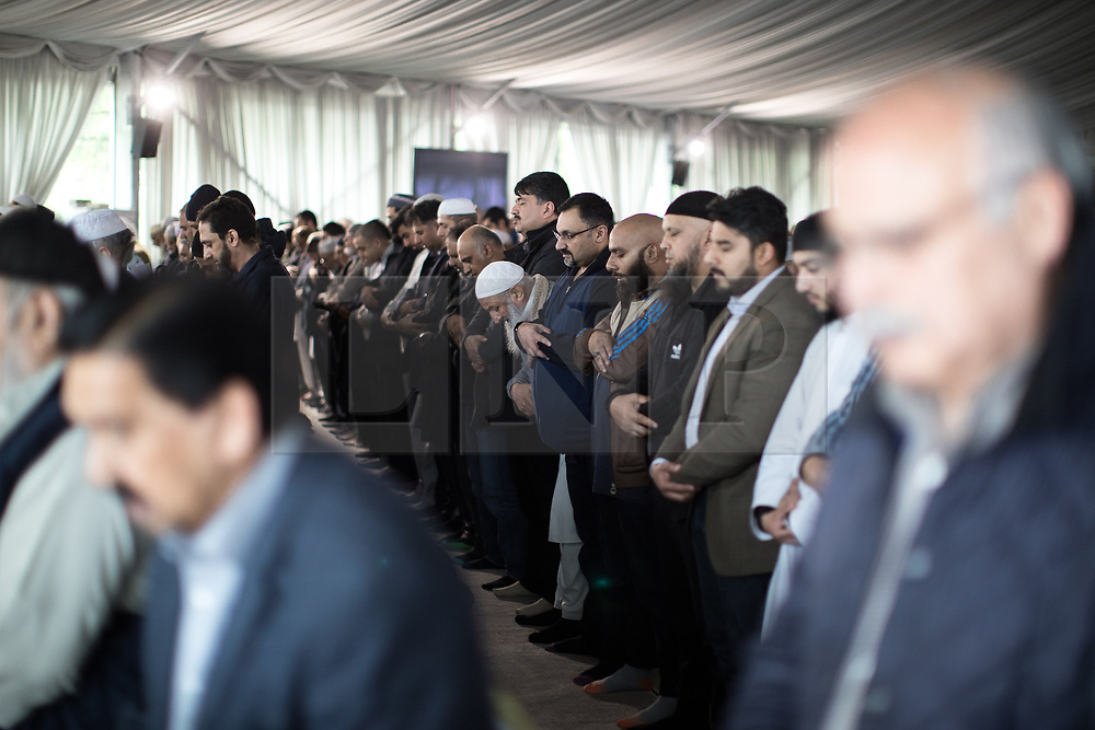 © Licensed to London News Pictures . 12/05/2017 . Manchester , UK . Thousands of people fill a mosque , inside a marquee at the British Muslim Heritage Centre in Whalley Range , Manchester , for the funeral of Mawlana Habib-ur-Rahman , at the British Muslim Heritage Centre , Whalley Range , Manchester . Rahman , a former maths teacher and then imam at Manchester Central Mosque , died aged 90 following heart problems . As a well-known leader of Manchester's Muslim community he promoted interfaith dialogue and met the Pope during a Papal visit to Manchester in 1982 . Due to the number attending , crowds attending the funeral had to be diverted to rooms in nearby buildings to listen to the service via loudspeaker . Photo credit : Joel Goodman/LNP