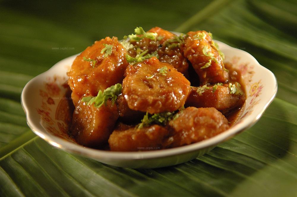 Katcha Kela ki Sabzi - Raw palantains cooked in tomato sauce ( Recipe available upon request )