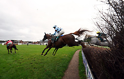 Fat Sam ridden by jockey James Davies (near side) clear a fence on their way to winning the Colliers Saves Business Rates Handicap Chase at Warwick Racecourse. Picture date: Thursday September 30, 2021.