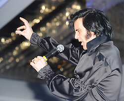 © Licensed to London News Pictures. 07/01/2012. BIRMINGHAM, UK.  Patrick Johns from Doncaster sings to the crowds as he takes part in the annual European Elvis Championship at the Hilton Metropole Hotel at the National Exhibition Centre today.  Photo credit: Alison Baskerville/LNP