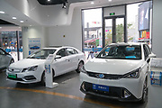 Hybrid/Electric car showroom Beijing City centre<br /><br />Electric vehicles are everywhere on China's roads, from battery powered pedal bikes to hybrid cars, electric buses and all types of service vehicles.