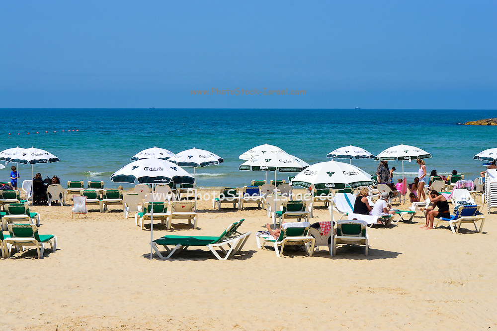 Tel Aviv beach with parasols and deck chairs